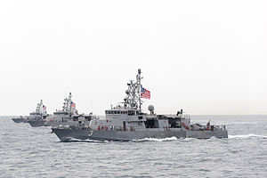 U.S. Navy Cyclone-class coastal patrol ships assigned to Patrol Coastal Squadron 1 (PCRON 1), USS Hurricane (PC-3), USS Chinook (PC-9) and USS Typhoon (PC-5), transit in formation during a divisional tactics exercise in the Persian Gulf.
