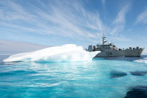 Members of Her Majesty's Canadian Ship SASKATOON carefully maneuver the ship around a large piece of ice while travelling through the Amundsen Gulf on August 22, 2015 during Operation NANOOK. Photo: Cpl Donna McDonald, AETE Imagery Data Systems. ET2015-5751-04