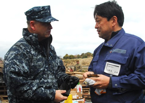 Rear Adm. Jeffrey S. Jones, director of Coalition Naval Advisory and Training Team, speaks with a resident of Oshima, to discuss the progress of disaster relief operations. Marines and sailors assigned to the 31st Marine Expeditionary Unit are on Oshima Island to help clear a harbor and assist with cleaning debris from roads and a local school in support of Operation Tomodachi.Petty Officer 3rd Class Eva Mari.
