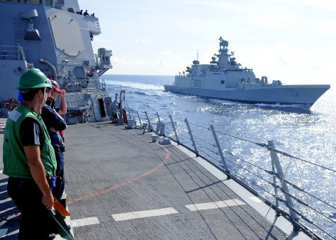 Sailors assigned to the guided-missile destroyer USS Halsey (DDG 97) stand in ranks as the Indian navy destroyer Sapura (F-48) pulls alongside Halsey during a Malabar 2012 exercise.