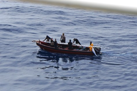 """Nigerian pirates taunting the crew of a tanker in the Agbami oil field in broad daylight in April 2016. Note the 200 hp main outboard engine and white """"battle"""" flag traditionally used by the Movement for the Emancipation of the Niger Delta (2006-9)."""
