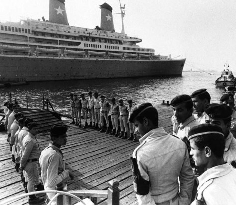 Egyptian central security police guarding the gangplank on which diplomats and others go to and from the Italian cruise liner ?Achille Lauro? which arrived, Thursday, Oct. 10, 1985 in Port Said in this port after being hijacked by four Palestinian for more than 48-hours. The four hijackers has left Egypt after they surrendered go to the Egyptian authorities on Wednesday. (AP Photo)