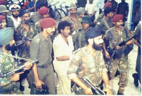 Indian commandos escort the captured leader of the attempted coup in 1988.