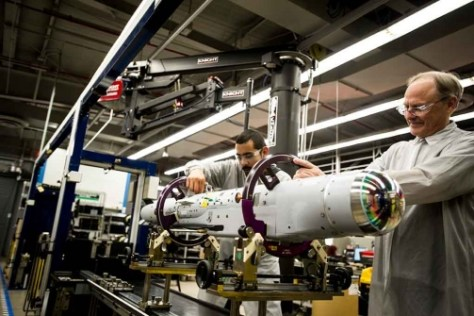 Employees work on missile production at Raytheon Missile Systems's facility in Tuscon, AZ.