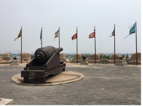"""The Dagu Fort Memorial, Tianjin China (大沽口炮台纪念馆, 天津). It was built and modernized in the late nineteenth century in an effort to resist foreign amphibious attacks on Beijing. A sign helpfully notes that the memorial, """"makes clear to subsequent generations: those who lag behind will be bullied, it is only through strength and prosperity that peace can be achieved."""" 昭示后人:落后就要挨打,强盛才有安宁. (Author Photo)"""