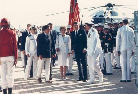 Navy Secretary John Lehman greeting President and Mrs. Reagan aboard the battleship Iowa for 100th anniversary celebration of the Statue of Liberty on July 4, 1986 in New York Harbor.