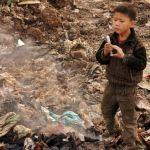 Cina: vivere tra i rifiuti, 28 immagini