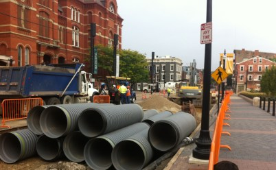 New sewer pipes arrive for installation.