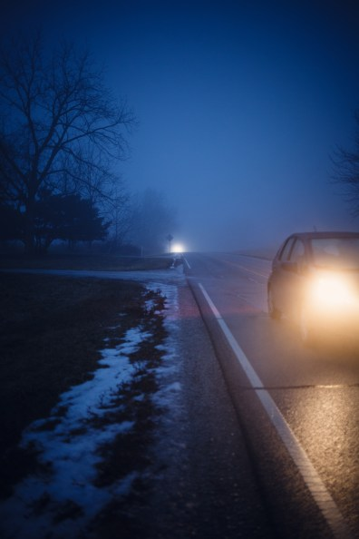 headlights on a country road in the dark