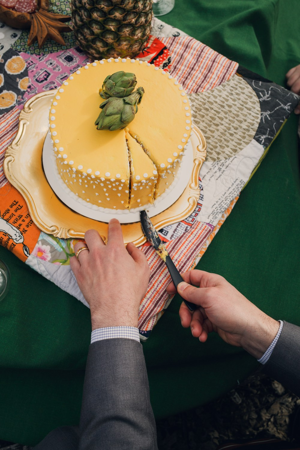 wes anderson styled wedding shoot with yellow 1960's cake
