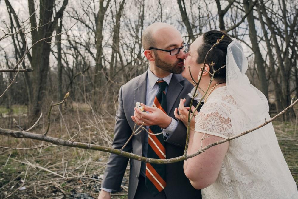 wedding couple kissing and eating wedding cake