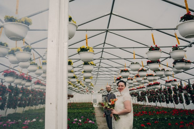 boho wedding couple in spring greenhouse