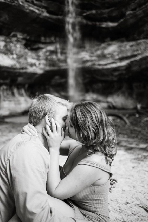 couple kissing waterfall
