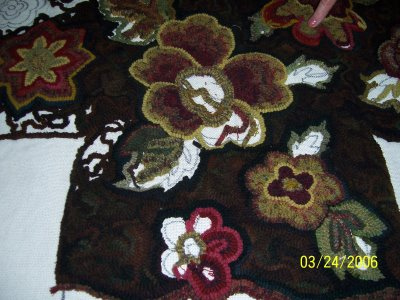 My rug hooking progress on my footstool