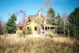 Cabin that influenced the rug hooking pattern
