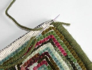 The first step in whipping the edge on a hooked rug