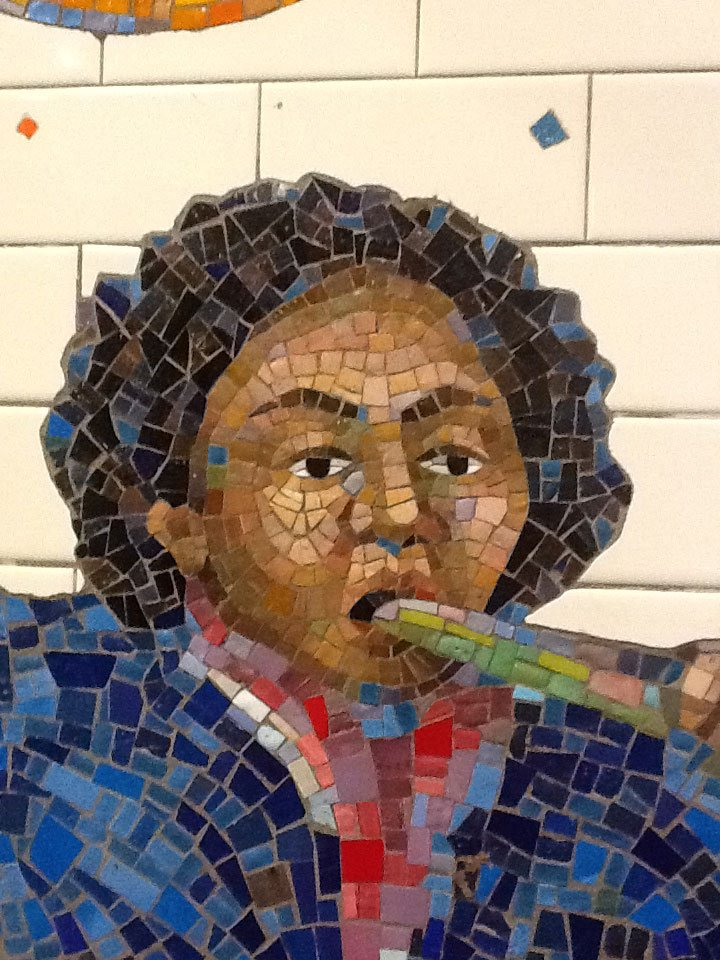 Tile art NYC subway boy playing instrument