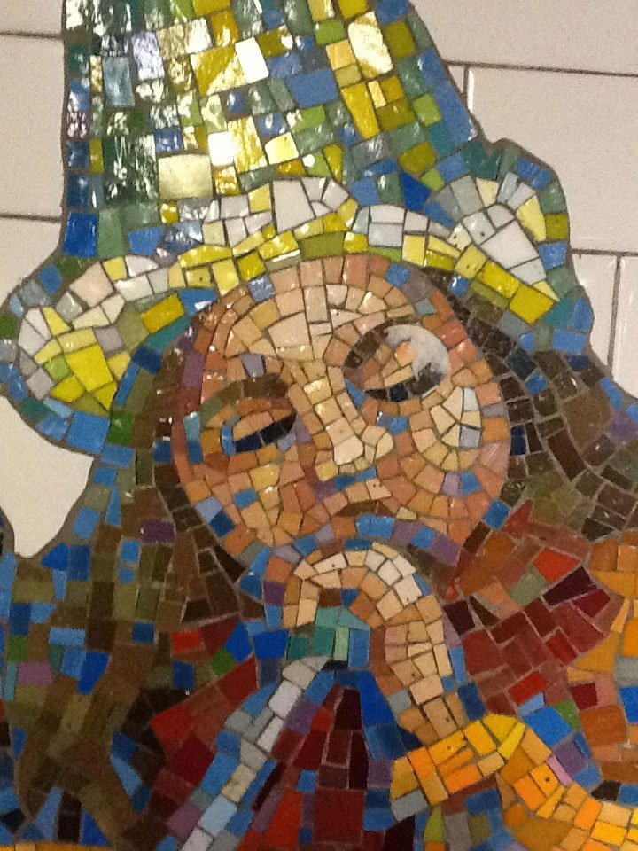 Tile art NYC subway girl playing instrument