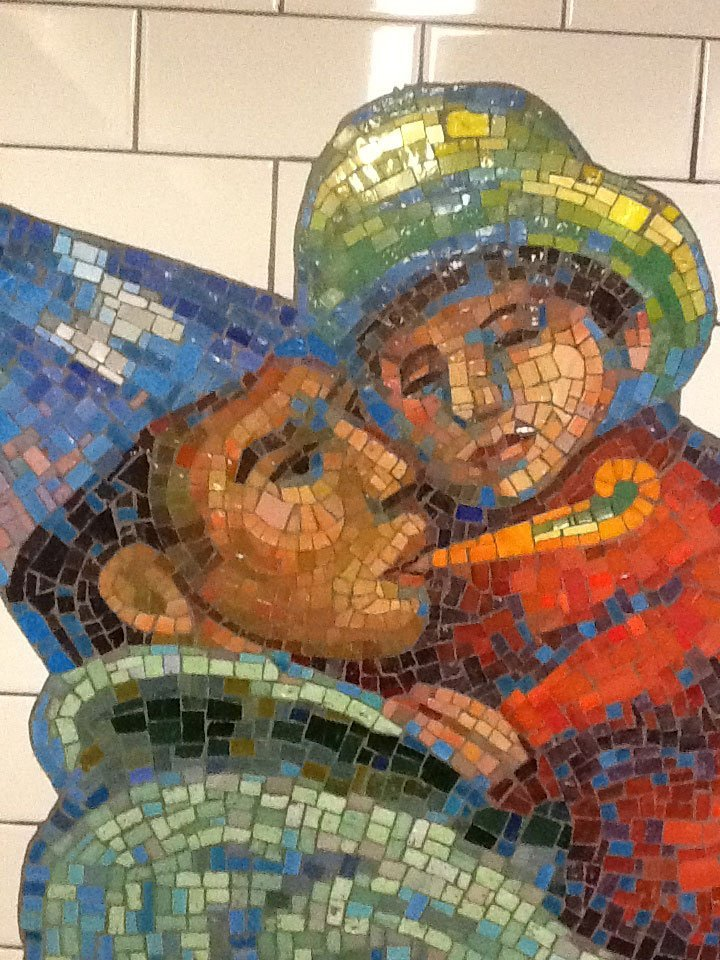 Tile art NYC subway closeup of man holding child