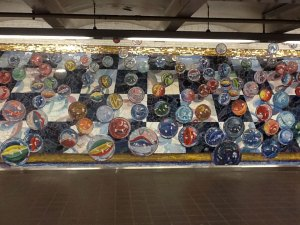 tile art of marbles on NYC subway wall