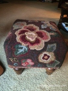 Pocketful Footstool hooked by Pat Cassidy