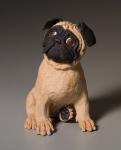 Dog sculpture in clay