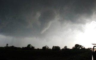 A funnel cloud forms over Memphis.