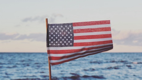 American flag over water