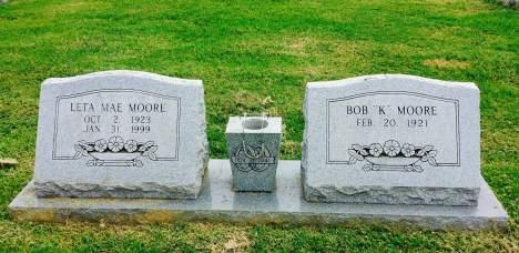 white roses headstone