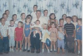 Grandpa George with all of his grandchildren: Sheila to his left, in the blue romper; I'm directly behind her