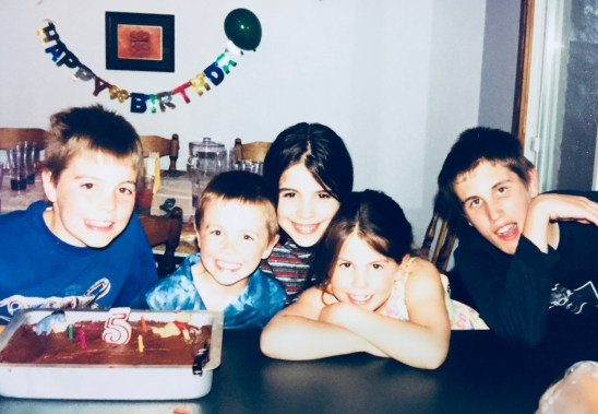 Charity and her siblings when they were younger at a birthday party for Eythan.