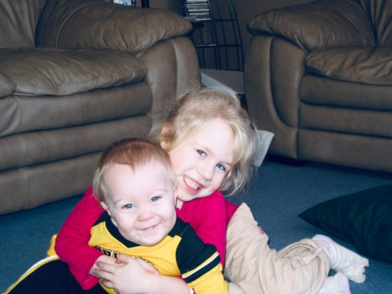 Jaelyn and Brennen as toddlers in the living room