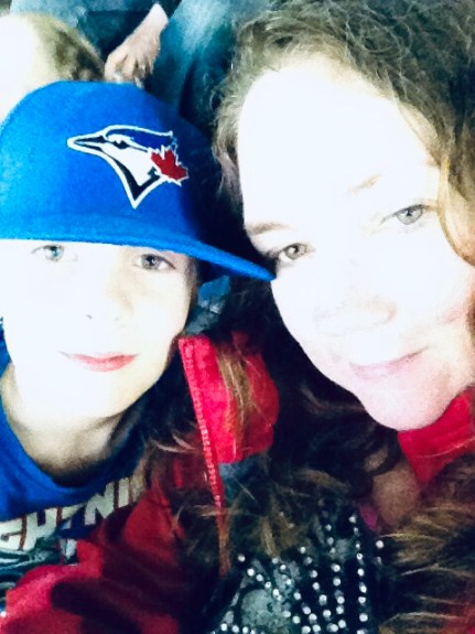 Melody and Brennen. Brennen is wearing a Blue Jay's baseball cap.
