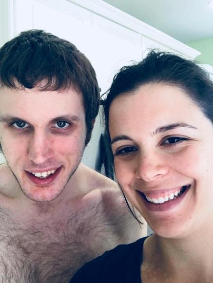 Charity taking a selfie of her and Kyle. They are both smiling.
