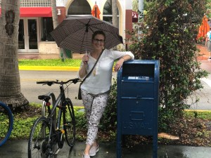 me standing by a mail box with an umbrellla