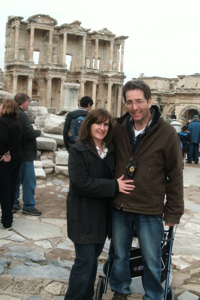 A husband and wife on vacation in the Mediterranean.
