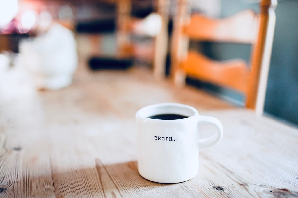 coffee mug with the word begin on it