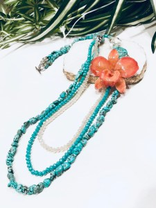 turquoise necklace with a coral glazed orchid