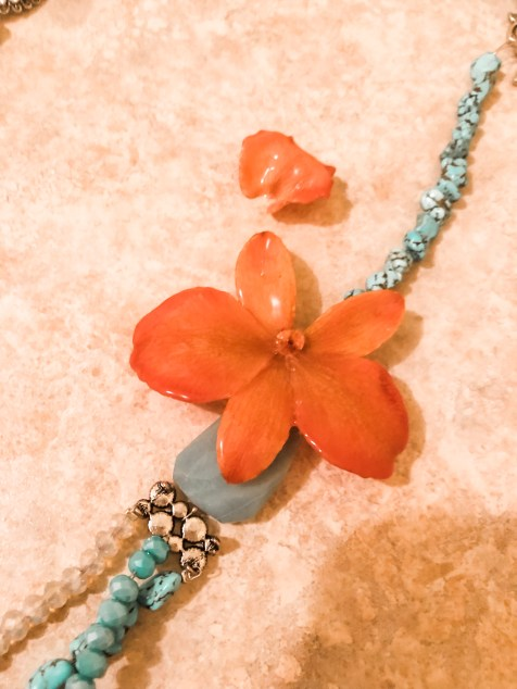 necklace with a real orchid.