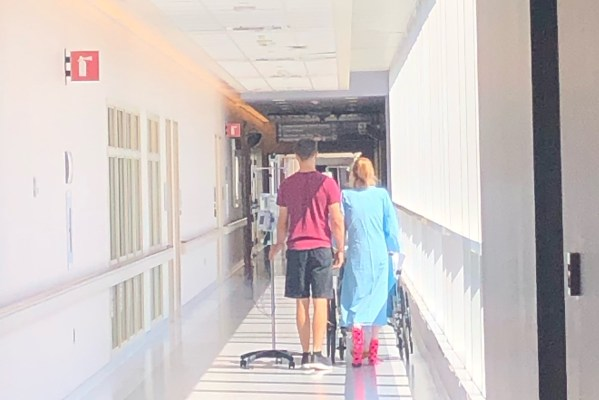 Eythan and Jazmin walking the hospitals corridor.