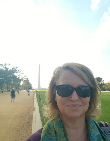Walking along the National Mall, with a view of the Washington Monument.