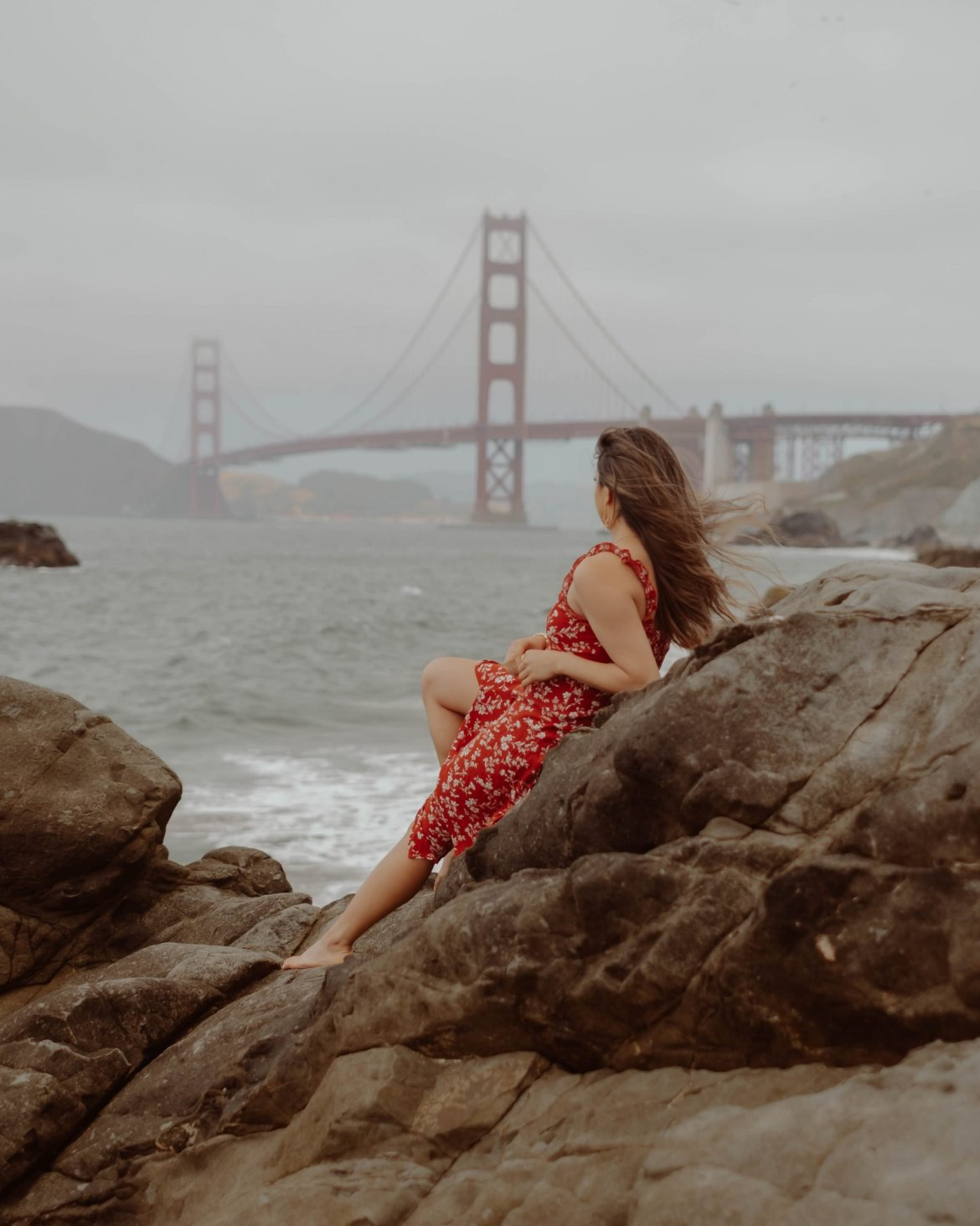 girl in red dress at baker beach san Francisco California