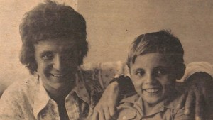 Archival photo of man with a young boy smiling.