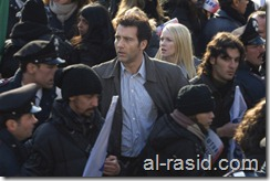 """(Center) Clive Owen as """"Louis Salinger"""" and (center, behind) Naomi Watts as """"Eleanor Whitman"""" in Columbia Pictures' thriller THE INTERNATIONAL."""