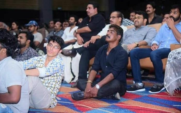antony perumbavoor sitting on the floor for aadhi celebration