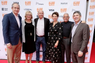 """Brian L. Roberts, Chairman and CEO of Comcast Corporation, Producer Janet Healy, Producer Christopher Meledandri, Donna Langley, Chairman of Universal Pictures, Ron Meyer, Vice Chairman of NBCUniversal, and Jeff Shell, Chairman of Universal Filmed Entertainment Group, seen at Universal Pictures """"Sing"""" at the 2016 Toronto International Film Festival on Sunday, Sept. 11, 2016, in Toronto. (Photo by Eric Charbonneau/Invision for Universal Pictures/AP Images)"""
