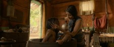 "Rohan Chand as ""Mowgli"" and Freida Pinto as ""Messua"" in the Netflix film ""Mowgli: Legend of the Jungle"""