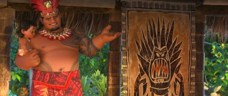 """MOANA - CHILL OUT – Chief Tui and Moana stand before a tapa cloth that features a chilling design inspired by Marshmallow from 2013's Oscar®-winning feature """"Frozen."""" ©2016 Disney. All Rights Reserved."""