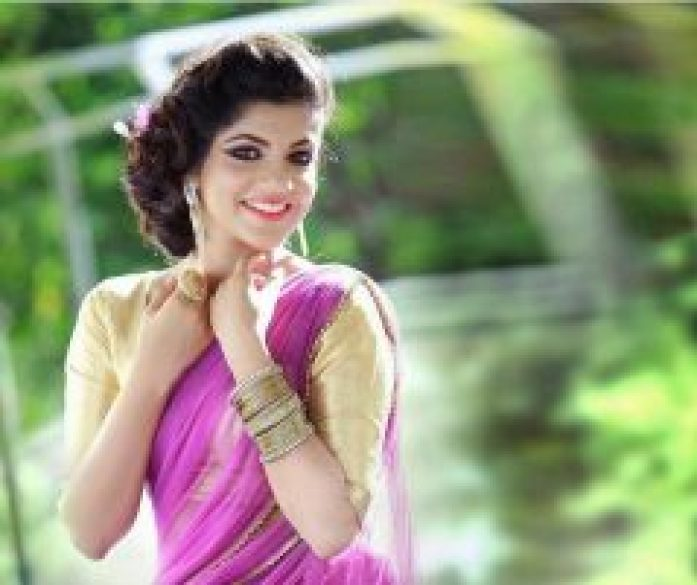 Cute Aparna in Pink Saree