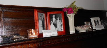 family photos, old jewelry and silver made special mantle decor